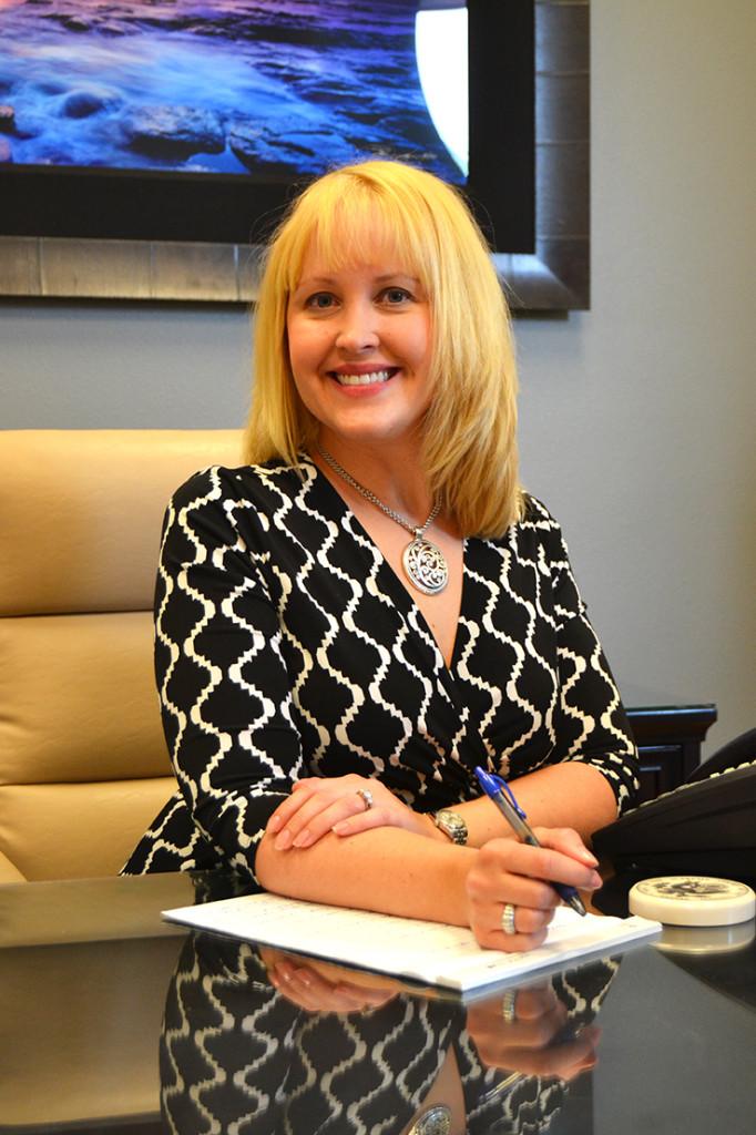Jeana at desk 1 Website