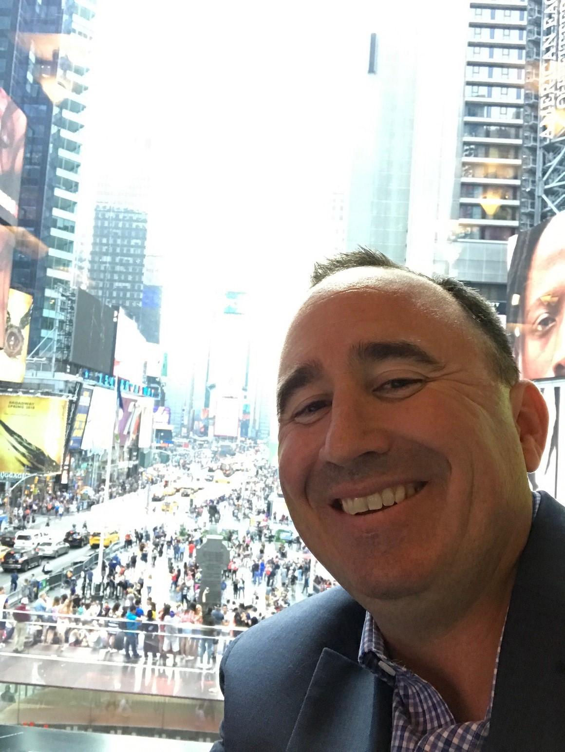 Joel in front of window.jpg